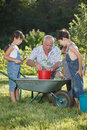Children is helping her grandfather in the garden teaches to plant plants Royalty Free Stock Photos