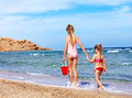 Children holding hands walking on the beach. Royalty Free Stock Photos