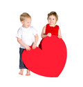 Children with huge heart made ​​of red paper isolated on white background Royalty Free Stock Photography