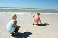 Children Hunting for Seashell at Beach Royalty Free Stock Photos