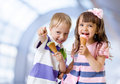Children with icecream cone indoor in abstract cafe Royalty Free Stock Images