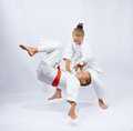 Children  in judogi are training throws Royalty Free Stock Photo