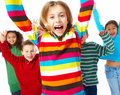 Children jumping with hands raised on white Stock Images