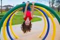 Children kid girl upside down on a park ring playground game Royalty Free Stock Photos