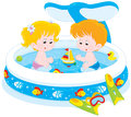 Children in a kids pool little girl and boy playing an inflatable paddling summer day Royalty Free Stock Photography