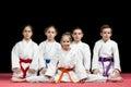 Children in kimono sitting on tatami on martial arts seminar. Selective focus Royalty Free Stock Photo