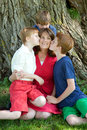 image photo : Children kiss mom