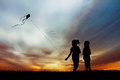 Children with kite silhouette at sunset Royalty Free Stock Photo