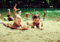Children on the lake swimming in and sprinkles Royalty Free Stock Images