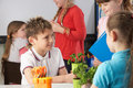 Children learning about plants in school class Stock Photography