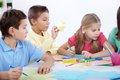 Children at leisure smart schoolboys and schoolgirl drawing with colorful highlighters Stock Photo