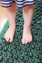 Children little feet standing on massage mat Royalty Free Stock Photography