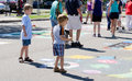 Children look at street art little boys colorful chalk that decorates the in st joseph michigan Stock Photos