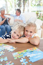 Children looking at the camera in the living room Royalty Free Stock Photo