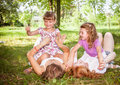 Children lying on green grass outdoors Stock Photography