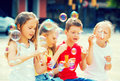 Children make soap bubles outdoors Royalty Free Stock Photo