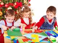Children making decoration for christmas boy and girl Royalty Free Stock Image