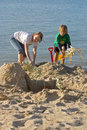 Children making sand castles Stock Photos