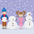 Children making snowmen. Royalty Free Stock Photography