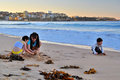 Children at manly some enjoying their time playing sands in beach this beach is located in the northern beach of sydney Stock Image