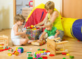 Children and mother collecting toys Royalty Free Stock Photo