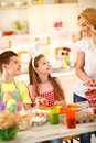 Children with mother preparing Easter Royalty Free Stock Photo