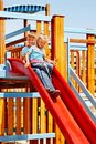 Children move out to slide in playground happy Royalty Free Stock Images