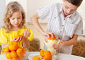 Children with oranges Royalty Free Stock Images