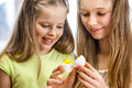 Children paint easter eggs at home happy Stock Images