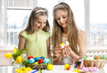 Children paint easter eggs at home school Royalty Free Stock Image