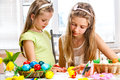 Children paint easter eggs at home two Royalty Free Stock Image