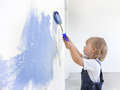 Children paint indoors happy wall Stock Photo