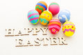 Children painted easter egg with wooden text close up Royalty Free Stock Photo