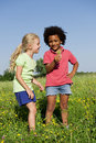 Children picking flowers up Royalty Free Stock Photo