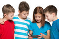 Children plaing with a new gadget group of four are playing on the white background Stock Images