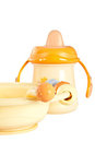 Children plate and plastic baby bottle. Royalty Free Stock Photo