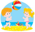 Children play a ball little girl and boy playing with big colorful on beach Royalty Free Stock Photography