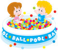 Children play in a ball pool little girl and boy playing with color balls Stock Image