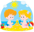 Children play on a beach little girl and boy building sand castle Stock Images