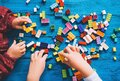 Children play and build with colorful toy bricks, plastic blocks Royalty Free Stock Photo