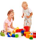 Children play building blocks. Stock Photography