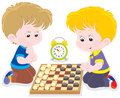 Children play checkers little boys playing in draughts on the floor Royalty Free Stock Image