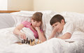 Children play chess in a bed Royalty Free Stock Photography