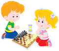 Children play chess little boy and girl playing Stock Photo