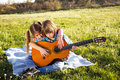 Children play guitar happy kids Royalty Free Stock Images