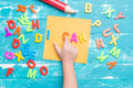 Children play plastic letters to combinations word