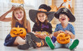 Children play with pumpkins