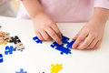 Children play puzzle close child hand playing with a number Royalty Free Stock Photos