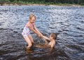 Children play in water boy and girl at the beach Stock Photos