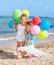 Children playing with balloons at the beach Royalty Free Stock Images